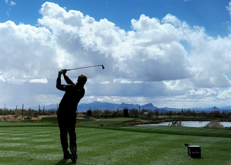 (EDITORS NOTE: A [graduated] color filter was used for this image.) MARANA, AZ - FEBRUARY 27:  Luke Donald of England hits his tee shot on the third hole during the final round of the Accenture Match Play Championship at the Ritz-Carlton Golf Club on February 27, 2011 in Marana, Arizona.