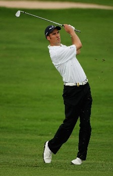 MALELANE, SOUTH AFRICA - DECEMBER 06:  Ross Fisher of England plays his second shot into the 10th green during the first round of The Alfred Dunhill Championship at The Leopard Creek Country Club on December 6, 2007 in Malelane, South Africa.  (Photo by Warren Little/Getty Images)