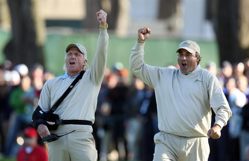 SAN FRANCISCO - OCTOBER 09:  Greg Norman of Australia and the captain of the International Team (left) celebrates with Angel Cabrera of Argentina as Tim Clark holes an eagle putt to win his match at the 18th hole during the Day Two Fourball Matches in The Presidents Cup at Harding Park Golf Course on October 9, 2009 in San Francisco, California  (Photo by David Cannon/Getty Images)