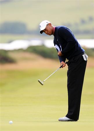 TURNBERRY, SCOTLAND - JULY 13:  Tiger Woods of the USA putting on the 14th green during the practice round of the 138th Open Championship on July 13, 2009 on the Ailsa Course, Turnberry Golf Club, Turnberry, Scotland.  (Photo by Harry How/Getty Images)