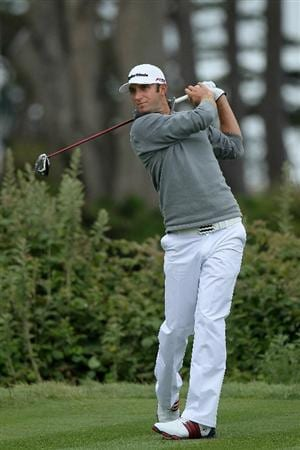 PEBBLE BEACH, CA - JUNE 18:  Dustin Johnson watches his tee shot on the 11th hole during the second round of the 110th U.S. Open at Pebble Beach Golf Links on June 18, 2010 in Pebble Beach, California.  (Photo by Stephen Dunn/Getty Images)