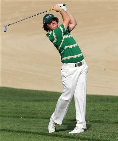 DUBAI, UNITED ARAB EMIRATES - FEBRUARY 07:  Rory McIlroy of Northern Ireland plays his second shot at the 14th hole during the final round of the 2010 Omega Dubai Desert Classic on the Majilis Course at the Emirates Golf Club on February 7, 2010 in Dubai, United Arab Emirates.  (Photo by David Cannon/Getty Images)