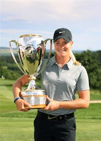 CALGARY, AB - SEPTEMBER 06 : Suzann Pettersen of Norway holds the championship trophy after the final round of the Canadian Women's Open at Priddis Greens Golf & Country Club on September 6, 2009 in Calgary, Alberta, Canada. (Photo by Hunter Martin/Getty Images)