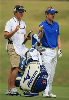 PONTE VEDRA BEACH, FL - MAY 09:  Luke Donald of England, with his caddy and brother Christian, prepares to play into the 7th green during the second round of THE PLAYERS Championship on THE PLAYERS Stadium Course at TPC Sawgrass on May 9, 2008 in Ponte Vedra Beach, Florida.  (Photo by Richard Heathcote/Getty Images)