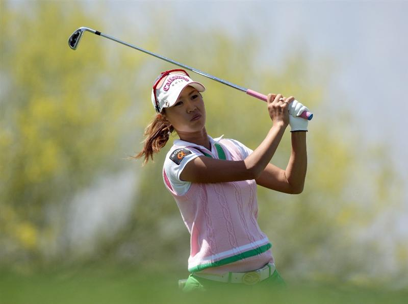 RANCHO MIRAGE, CA - APRIL 03:  Momoko Ueda of Japan plays her tee shot at the 8th hole during the second round of the 2009 Kraft Nabisco Championship, at the Mission Hills Country Club on April 3, 2009 in Rancho Mirage, California  (Photo by David Cannon/Getty Images)