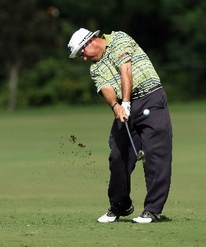 LAKE BUENA VISTA, FL - NOVEMBER 02:  Rich Beem hits his second shot at the 17th hole on the Magnolia Course during the second round of The Childrens Miracle Network Classic held on the Palm and Magnolia Courses at The Disney Shades of Green Resort, on November 2, 2007 in Lake Buena Vista, Florida.  (Photo by David Cannon/Getty Images)