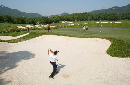 SHENZHEN, CHINA - NOVEMBER 21:  Markus Brier of Austria plays a bunker shot during the Pro - Am of the Omega Mission Hills World Cup at the Mission Hills Golf Resort on November 21, 2007 in Shenzhen, China.  (Photo by Stuart Franklin/Getty Images)