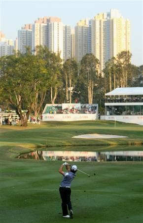 HONG KONG, CHINA - NOVEMBER 21:  Rory McIlroy of Northern Ireland plays his approach shot on the 18th hole during the second round of the UBS Hong Kong Open at the Hong Kong Golf Club on November 21, 2008 in Fanling, Hong Kong.  (Photo by Stuart Franklin/Getty Images)
