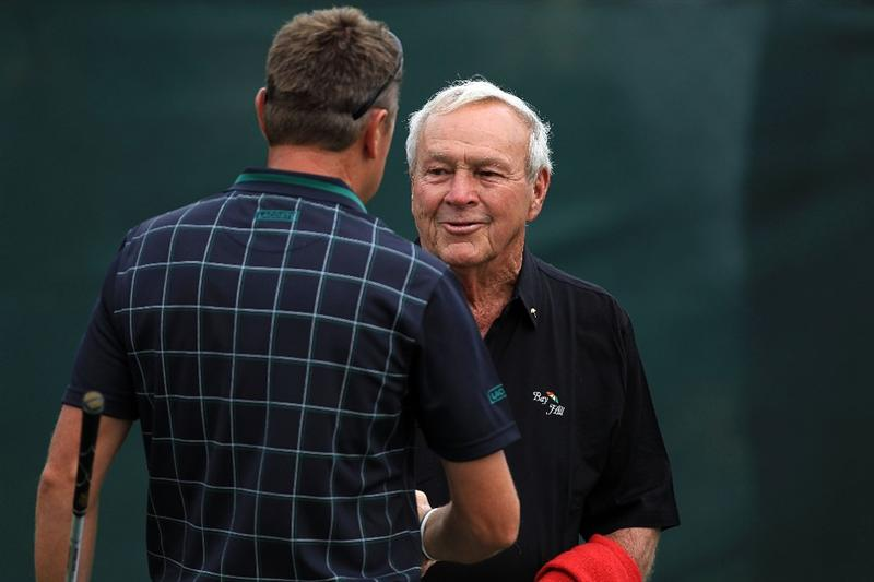 ORLANDO, FL - MARCH 25:  Arnold Palmer of the USA says hello to Robert Allenby of Australia on the course during the first round of the Arnold Palmer Invitational presented by Mastercard at the Bayhill Club and Lodge, on March 25, 2010 in Orlando, Florida.  (Photo by David Cannon/Getty Images)