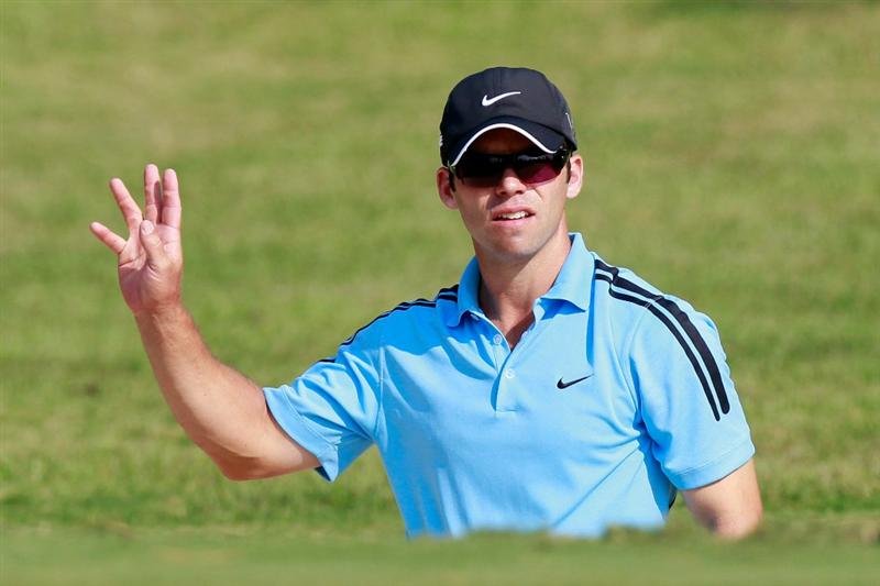 ATLANTA - SEPTEMBER 23:  Paul Casey of England reacts after his sand shot on the 14th green during the first round of THE TOUR Championship presented by Coca-Cola at East Lake Golf Club on September 23, 2010 in Atlanta, Georgia.  (Photo by Kevin C. Cox/Getty Images)