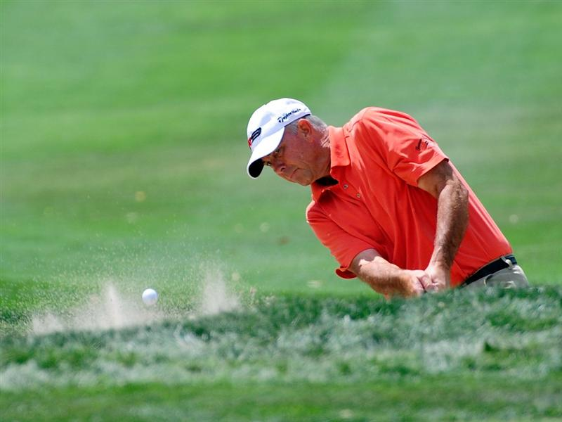 PALM HARBOR, FL - MARCH 21:  Tom Lehman plays a shot from the bunker on the 1st hole during the third round of the Transitions Championship at the Innisbrook Resort and Golf Club on March 21, 2009 in Palm Harbor, Florida.  (Photo by Sam Greenwood/Getty Images)