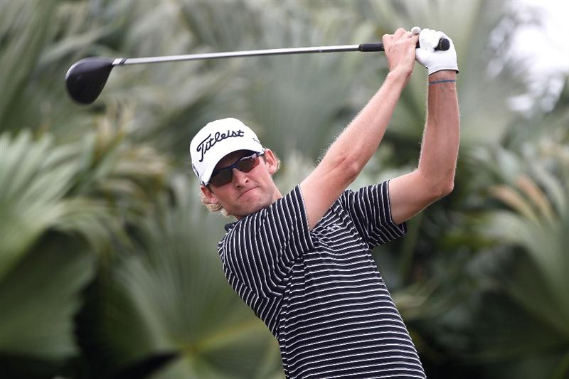 DORAL, FL - MARCH 11:  Michael Sim of Australia watches his tee shot on the eighth tee during the first round of the 2010 WGC-CA Championship at the TPC Blue Monster at Doral on March 11, 2010 in Doral, Florida.  (Photo by Scott Halleran/Getty Images)