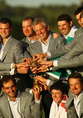 NEWPORT, WALES - OCTOBER 04:  European Team Captain Colin Montgomerie poses with the Ryder Cup and his team following Europe's 14.5 to 13.5 victory over the USA at the 2010 Ryder Cup at the Celtic Manor Resort on October 4, 2010 in Newport, Wales.  (Photo by Richard Heathcote/Getty Images)