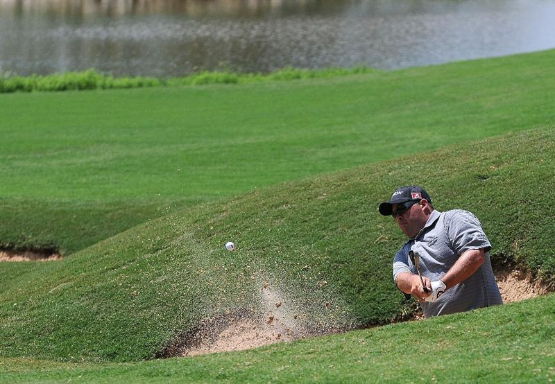SAN ANTONIO, TX - MAY 15:  Kevin Stadler hits out of the greenside bunker on the 16th hole during the second round of the Valero Texas Open at the TPC San Antonio on May 15, 2010 in San Antonio, Texas. (Photo by Marc Feldman/Getty Images)