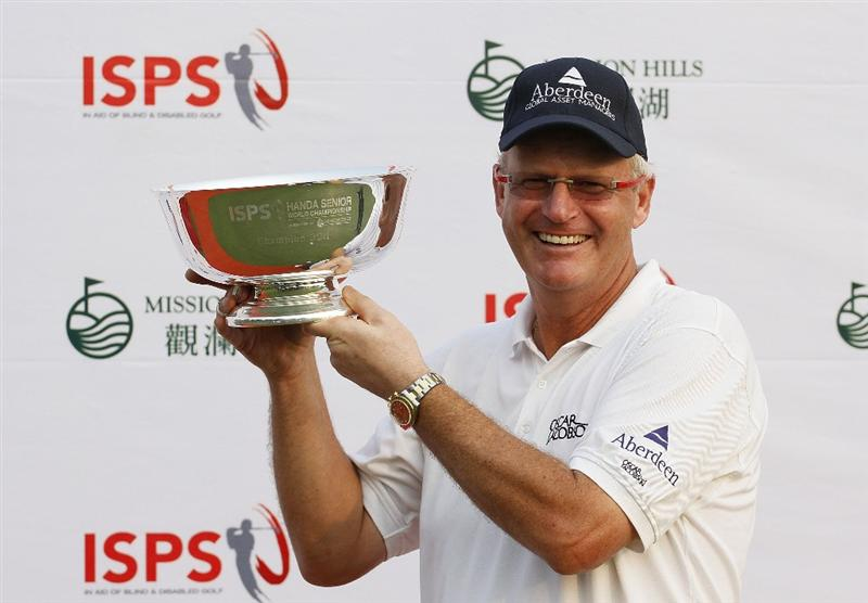 SHENZHEN, CHINA - MARCH 13:  Sandy Lyle of Scotland poses with the trophy after the final round of the ISPS Handa Senior World Championship presented by Mission Hills China and played on the World Cup Course, Mission Hills on March 13, 2011 in Shenzhen, Guangdong.  (Photo by Phil Inglis/Getty Images)