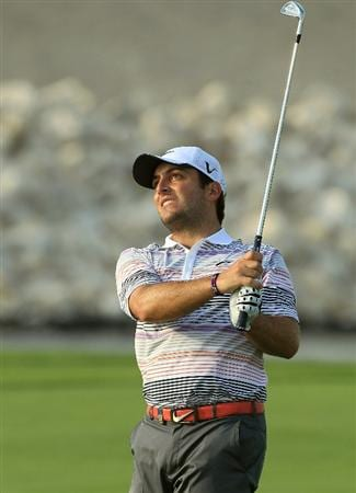 BAHRAIN, BAHRAIN - JANUARY 30:  Francesco Molinari of Italy plays his second shot at the 18th hole during the final round of the 2011 Volvo Champions held at the Royal Golf Club on January 30, 2011 in Bahrain, Bahrain.  (Photo by David Cannon/Getty Images)