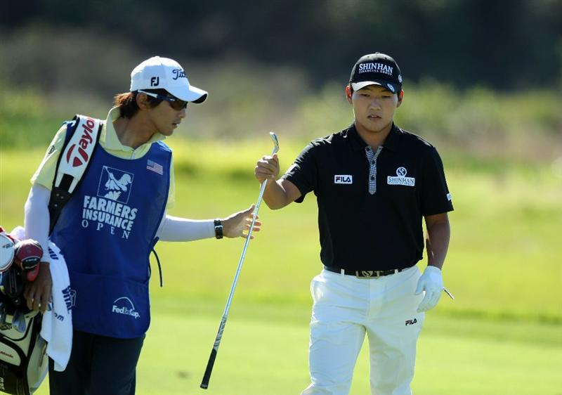 LA JOLLA, CA - JANUARY 27:  Sunghoon Kang of Korea hits off the 6th fairway during the first round of the Farmers Insurance Open at Torrey Pines on January 27, 2011 in La Jolla, California. (Photo by Donald Miralle/Getty Images)