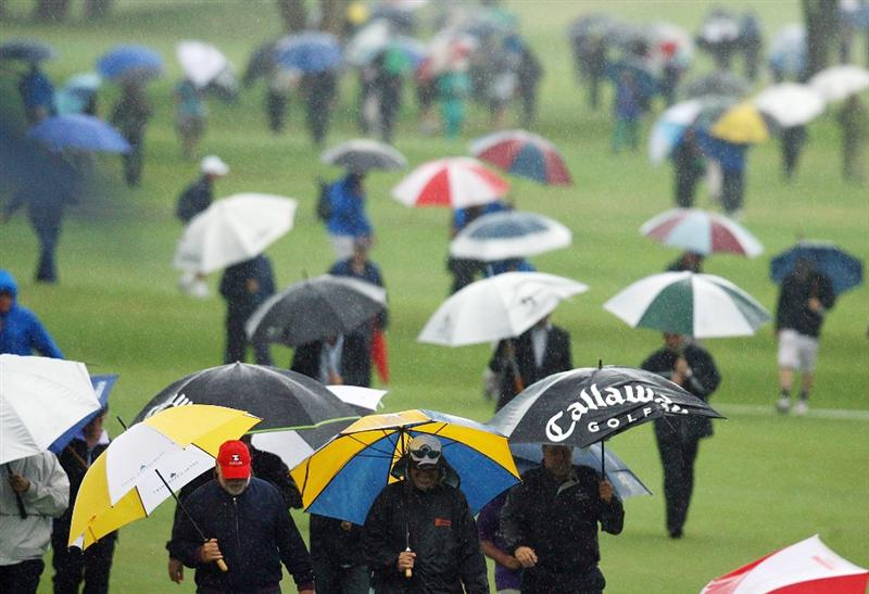 SYDNEY, AUSTRALIA - DECEMBER 12:  Spectators leave the course after bad weather halted play during the second round of the 2008 Australian Open at The Royal Sydney Golf Club on December 12, 2008 in Sydney, Australia.during the first round of the 2008 Australian Open at The Royal Sydney Golf Club on December 11, 2008 in Sydney, Australia.  (Photo by Mark Nolan/Getty Images)