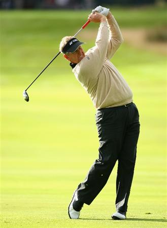 PERTH, UNITED KINGDOM - AUGUST 29:  Colin Montgomerie of Scotland hits his second shot on the 12th hole during the second round of The Johnnie Walker Championship at Gleneagles on August 29, 2008 at the Gleneagles Hotel and Resort in Perthshire, Scotland.  (Photo by Andrew Redington/Getty Images)