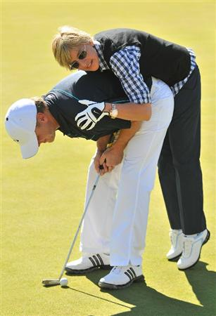 LAS VEGAS- OCTOBER 15: Ellen DeGeneres helps golfer Kevins Hooks with his  putting during the Championship Pro-Am of the Justin Timberlake Shriners Hospitals for Children Open held at the TPC Summerlin on October 15, 2008 in Las Vegas, Nevada. (Photo by Marc Feldman\Getty Images)