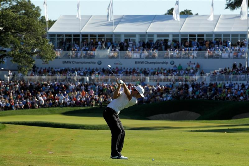 LEMONT, IL - SEPTEMBER 12:  Dustin Johnson hits an approach shot on the 18th hole during the final round of the BMW Championship at Cog Hill Golf & Country Club on September 12, 2010 in Lemont, Illinois.  (Photo by Scott Halleran/Getty Images)