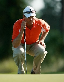 PORT SAINT LUCIE, FL - OCTOBER 28:  Bob Estes lines up a putt on the eighth hole during the final round of the Ginn Sur Mer Classic at Tesoro Resort October 28, 2007 in Port Saint Lucie, Florida.  (Photo by Doug Benc/Getty Images)