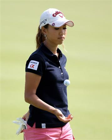 SINGAPORE - FEBRUARY 27:  Momoko Ueda of Japan during the third round of the HSBC Women's Champions at the Tanah Merah Country Club on February 27, 2010 in Singapore.  (Photo by Ross Kinnaird/Getty Images)