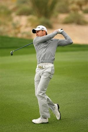 MARANA, AZ - FEBRUARY 20:  Camilo Villegas of Colombia plays his second shot on the 13th hole during round four of the Accenture Match Play Championship at the Ritz-Carlton Golf Club on February 20, 2010 in Marana, Arizona.  (Photo by Hunter Martin/Getty Images)