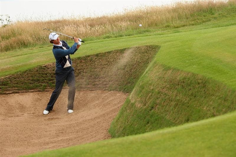TURNBERRY, SCOTLAND - JULY 15:   Adam Scott of Australia hits out of a bunker on the 11th hole during a practice round prior to the 138th Open Championship on the Ailsa Course, Turnberry Golf Club on July 15, 2009 in Turnberry, Scotland.  (Photo by Andrew Redington/Getty Images)