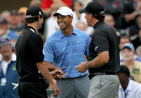 SAN DIEGO - JUNE 12:  Tiger Woods (C) smiles as he greets Adam Scott of Australia (L) and Phil Mickelson (R) on the first tee before starting their first round of the 108th U.S. Open at the Torrey Pines Golf Course (South Course) on June 12, 2008 in San Diego, California.  Woods shakes Scott's left hand due to an injury on the right hand of Scott. (Photo by Doug Pensinger/Getty Images)