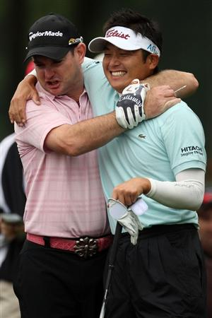 FARMINGDALE, NY - JUNE 19:  (L-R) Rory Sabbatini and Ryuji Imada of Japan clown around during the continuation of the first round of the 109th U.S. Open on the Black Course at Bethpage State Park on June 19, 2009 in Farmingdale, New York.  (Photo by Ross Kinnaird/Getty Images)