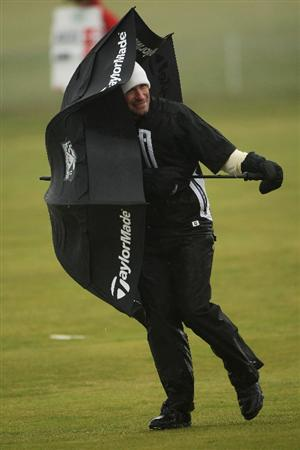 BALTRAY, IRELAND - MAY 16:  Steve Webster of England  struggles in the high winds and rain on the 11th hole during the third round of The 3 Irish Open at County Louth Golf Club on May 16, 2009 in Baltray, Ireland.  (Photo by Andrew Redington/Getty Images)