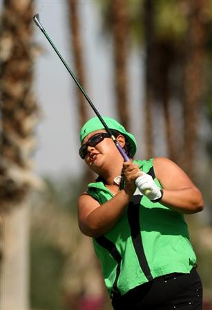 RANCHO MIRAGE, CA - APRIL 02:  Christina  Kim hits her tee shot on the fifth hole during the first round of the Kraft Nabisco Championship at Mission Hills Country Club on April 2, 2009 in Rancho Mirage, California.  (Photo by Stephen Dunn/Getty Images)