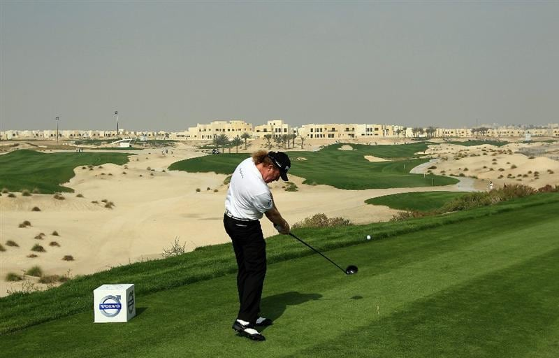 BAHRAIN, BAHRAIN - JANUARY 27:  Miguel Angel Jimenez of Spain plays his tee shot at the 3rd hole during the first round of the 2011 Volvo Champions held at the Royal Golf Club on January 27, 2011 in Bahrain, Bahrain.  (Photo by David Cannon/Getty Images)