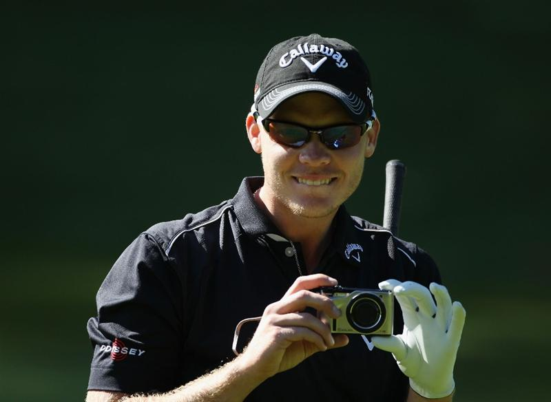 VIRGINIA WATER, ENGLAND - MAY 25:  Danny Willett of England takes a photo during the Pro-Am round prior to the BMW PGA Championship at Wentworth Club on May 25, 2011 in Virginia Water, England.  (Photo by Warren Little/Getty Images)