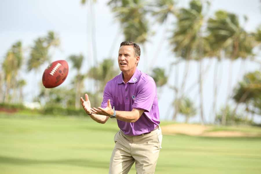 Michael Breed practicing his football skills.
