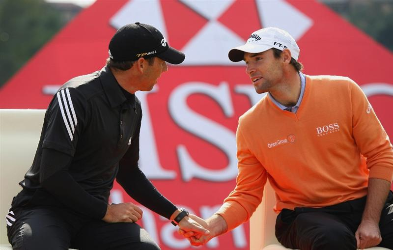 SHANGHAI, CHINA - NOVEMBER 10:  Sergio Garcia of Spain (L) is congratulated by Oliver Wilson of England during the prize giving ceremony after winning the HSBC Champions at the second play-off hole at Sheshan Golf Club on November 10, 2008 in Shanghai, China.  (Photo by Andrew Redington/Getty Images)