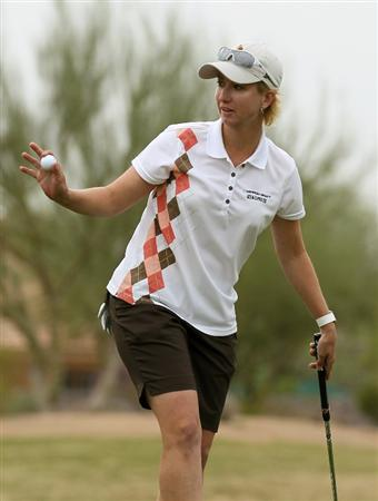 PHOENIX, AZ - MARCH 20:  Karrie Webb of Australia holds up her ball after making a birdie putt on the 14th hole during the final round of the RR Donnelley LPGA Founders Cup at Wildfire Golf Club on March 20, 2011 in Phoenix, Arizona.  (Photo by Stephen Dunn/Getty Images)