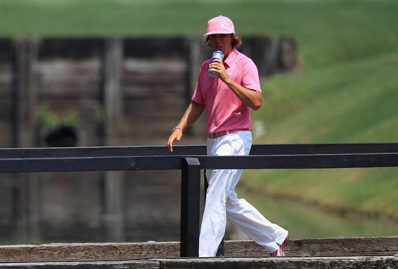 HILTON HEAD ISLAND, SC - APRIL 21:  Rickie Fowler walks across a bridge on the 7th hole during the first round of The Heritage at Harbour Town Golf Links on April 21, 2011 in Hilton Head Island, South Carolina.  (Photo by Streeter Lecka/Getty Images)