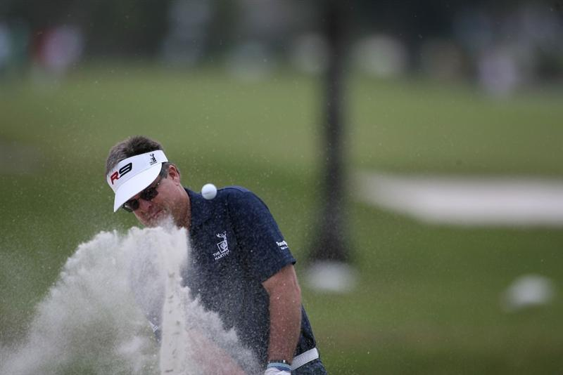 DORAL, FL - MARCH 11:  Kenny Perry hits out of the bunker on 11th hole during round one of the 2010 WGC-CA Championship at the TPC Blue Monster at Doral on March 11, 2010 in Doral, Florida.  (Photo by Marc Serota/Getty Images)
