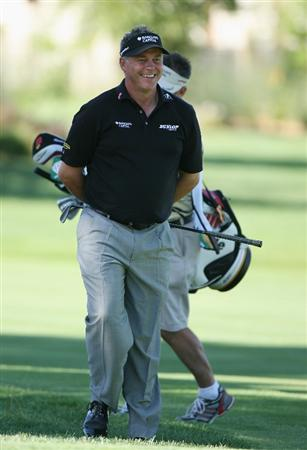PAARL, SOUTH AFRICA - DECEMBER 17:  Darren Clarke of Northern Ireland shares a joke on the seventh hole during the pro-am of the South African Open Championship at Pearl Valley Golf Club on December 17, 2008 in Paarl, South Africa.  (Photo by Warren Little/Getty Images)