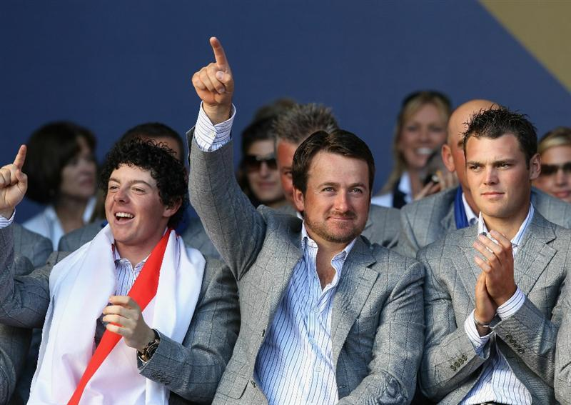 NEWPORT, WALES - OCTOBER 04:  Graeme McDowell of Europe waves to the crowds at the closing cermonies as Rory McIlroy and Martin Kaymer look on following Europe's 14.5 to 13.5 victory over the USA at the 2010 Ryder Cup at the Celtic Manor Resort on October 4, 2010 in Newport, Wales.  (Photo by Ross Kinnaird/Getty Images)