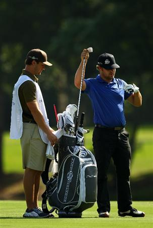 PONTE VEDRA BEACH, FL - MAY 07:  Ryan Moore (R) stands with his caddie J.D. Rastovski on the fairway of the 14t hole during the second round of THE PLAYERS Championship held at THE PLAYERS Stadium course at TPC Sawgrass on May 7, 2010 in Ponte Vedra Beach, Florida.  (Photo by Richard Heathcote/Getty Images)