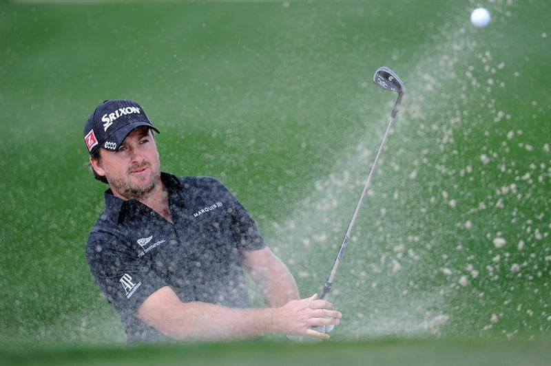MARANA, AZ - FEBRUARY 24: Graeme McDowell of Northern Ireland plays his bunker shot on the 13th hole during the second round of the Accenture Match Play Championship at the Ritz-Carlton Golf Club on February 24, 2011 in Marana, Arizona.  (Photo by Stuart Franklin/Getty Images)