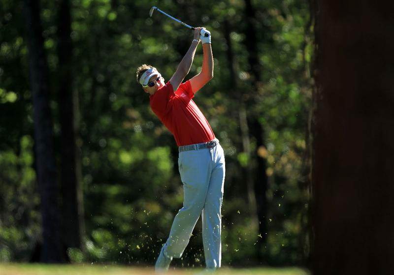 AUGUSTA, GA - APRIL 06:  Ian Poulter of England hits a shot during a practice round prior to the 2011 Masters Tournament at Augusta National Golf Club on April 6, 2011 in Augusta, Georgia.  (Photo by David Cannon/Getty Images)