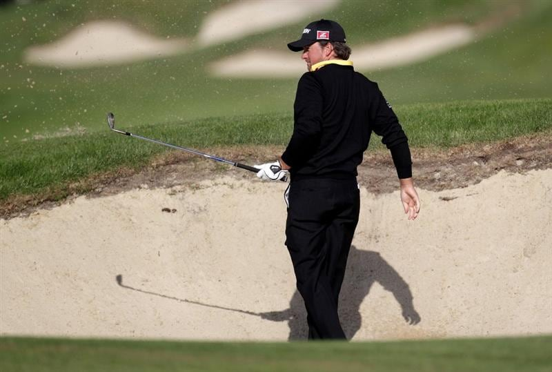 VIRGINIA WATER, ENGLAND - MAY 26:  Graeme McDowell of Northern Ireland plays his second shot from the bunker on the first hole during the first round of the BMW PGA Championship at Wentworth Club on May 26, 2011 in Virginia Water, England.  (Photo by Ross Kinnaird/Getty Images)
