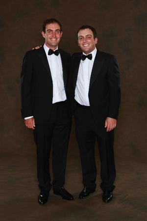 NEWPORT, WALES - SEPTEMBER 29:  Edoardo Molinari (L) and Francesco Molinari of the European Ryder Cup team pose prior to the 2010 Ryder Cup Dinner at the Celtic Manor Resort on September 29, 2010 in Newport, Wales.  (Photo by David Cannon/Getty Images)