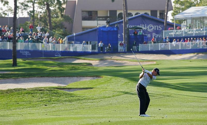 PALM HARBOR, FL - MARCH 19:  Steve Stricker hits his second shot on the 18th hole during the second round of the Transitions Championship at the Innisbrook Resort and Golf Club held on March 19, 2010 in Palm Harbor, Florida.  (Photo by Michael Cohen/Getty Images)