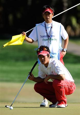 PALM HARBOR, FL - MARCH 22:  Ryo Ishikawa of Japan looks over a birdie putt on the seventh hole during the final round of the Transitions Championship at the Innisbrook Resort and Golf Club March 22, 2009 in Palm Harbor, Florida.  (Photo by Sam Greenwood/Getty Images)