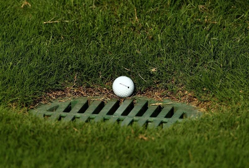 PONTE VEDRA BEACH, FL - MAY 08:  The ball of Lucas Glover sits in a drain grate after playing the 14th hole during the third round of THE PLAYERS Championship held at THE PLAYERS Stadium course at TPC Sawgrass on May 8, 2010 in Ponte Vedra Beach, Florida.  (Photo by Richard Heathcote/Getty Images)
